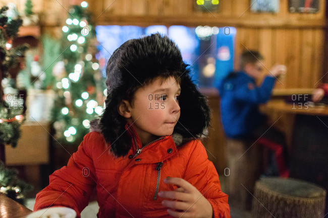 Little boy wearing a furry hat and coat