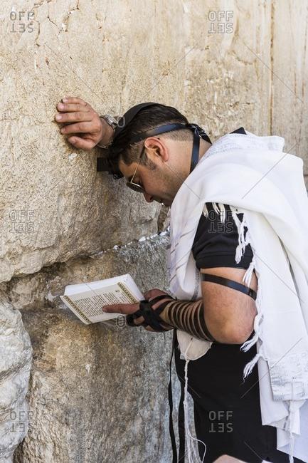 Israel, Jerusalem - June 27, 2013: Old Town, Jewish Quarter, Western Wall, prayer of a worshipper