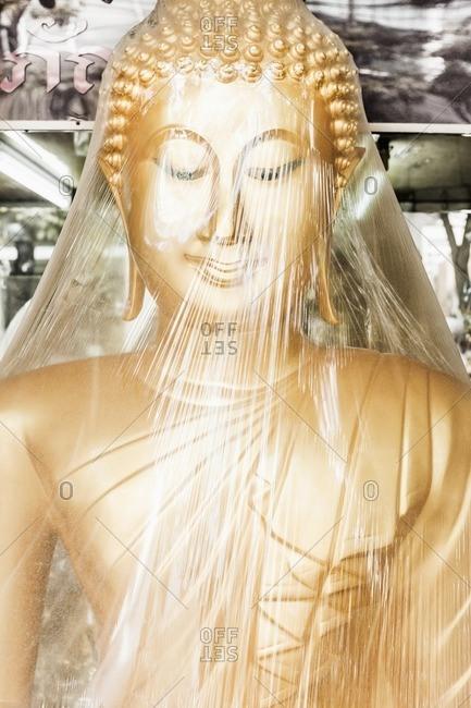 Thailand, Bangkok . New statue of buddha in a shop