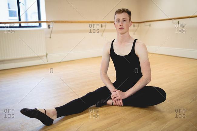Portrait of ballerina sitting in the studio