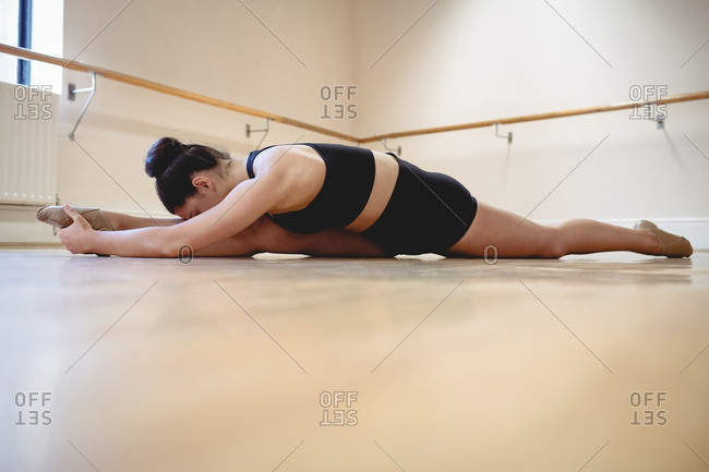 Ballerina performing a split in the studio
