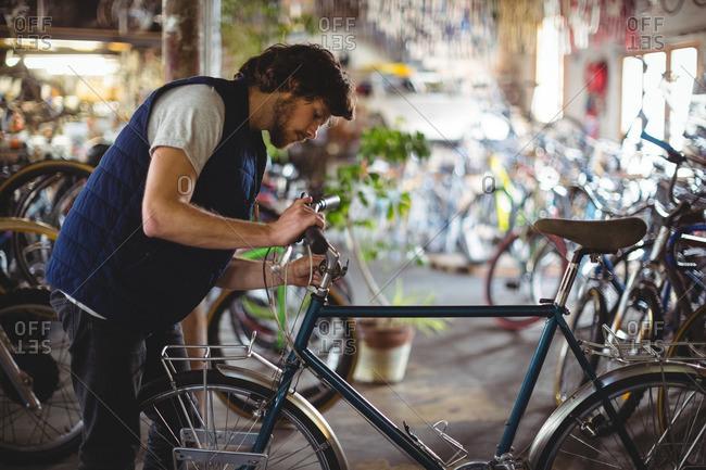 Mechanic examining bicycle in workshop