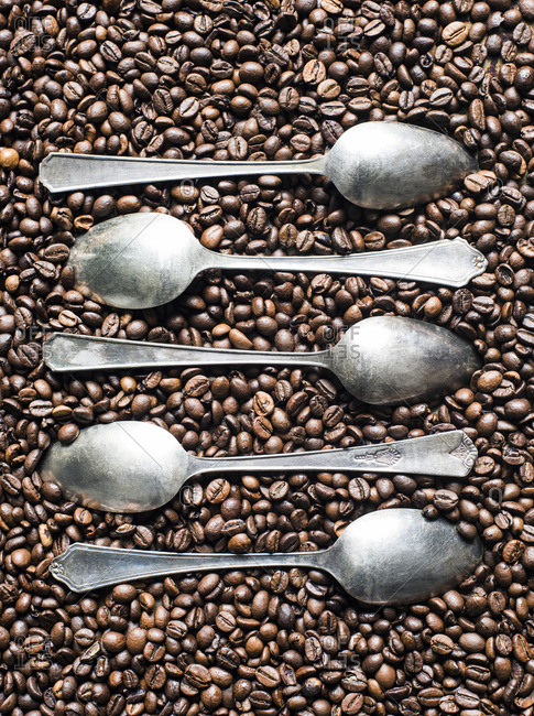 Coffee beans with vintage spoons