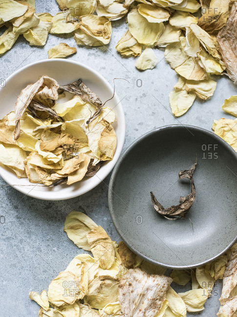 Dried flower petals in ceramic bowls