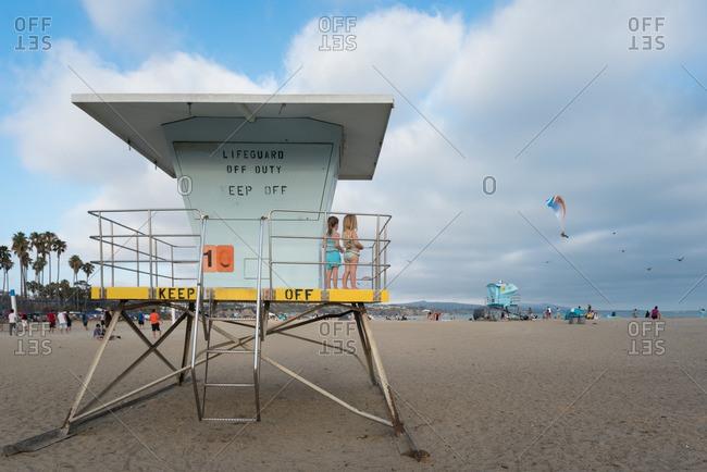 Girls on restricted lifeguard platform