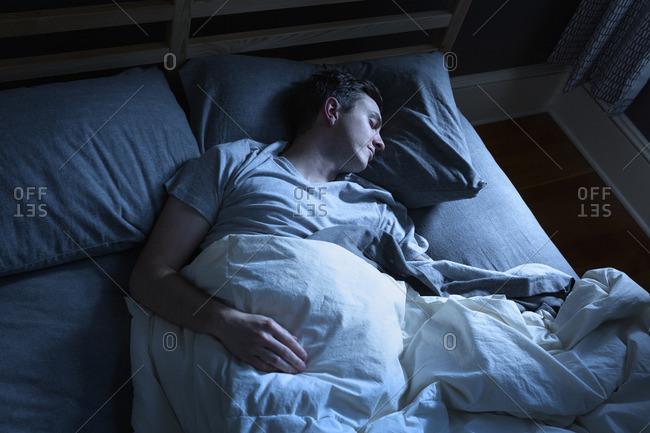 Man asleep in moonlight