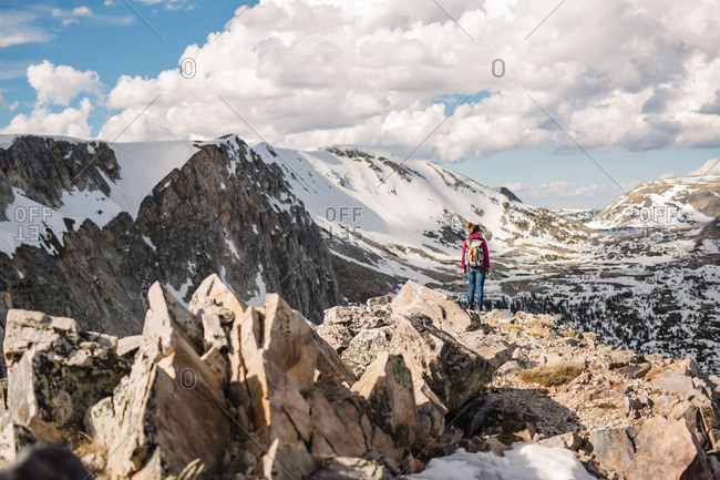 Woman backpacking through snowy mountains