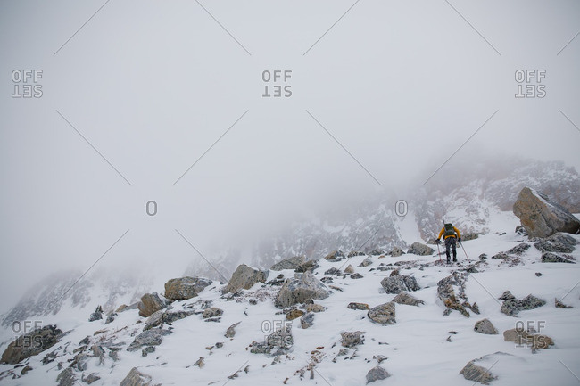 Person hiking up snowy mountains