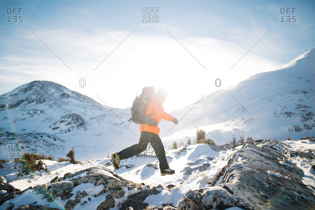 Person hiking in snowy mountains in Wyoming on a sunny day