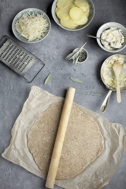 Pie dough and ingredients for a potato galette
