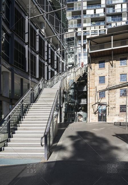 Sydney, Australia - November 2, 2016: Modern steps beside a traditional building at street level