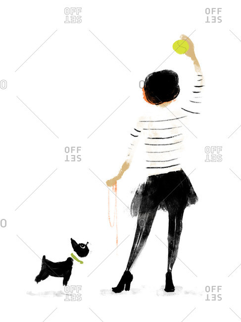 Stylish woman playing fetch with her dog