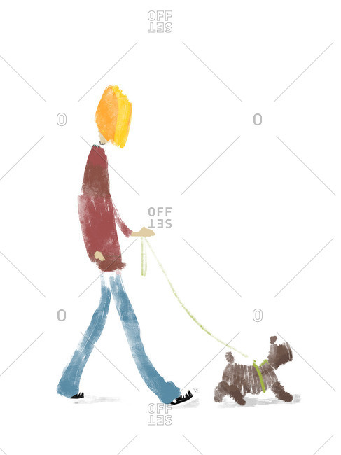Young man walking his dog on leash