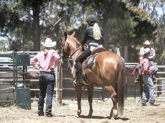 Woman on horse waiting to enter arena at rodeo in Western Australia