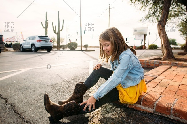Girl looking at her Western style boots