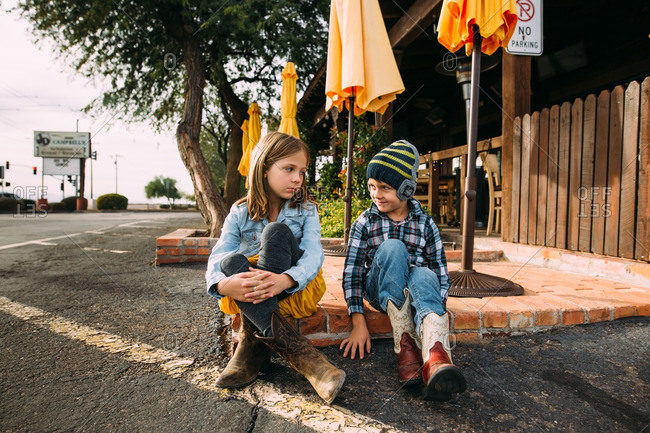 Staring siblings in Western style boots