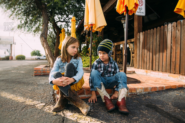 Annoyed siblings in Western style boots