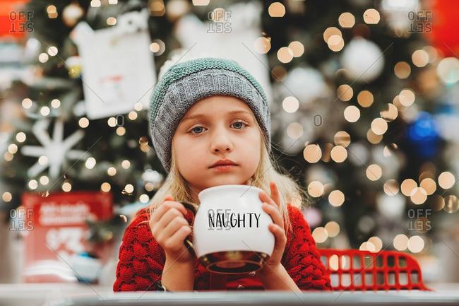 Girl with humorous Christmas mug