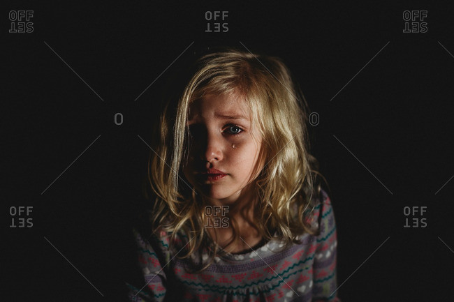 Girl crying in darkness