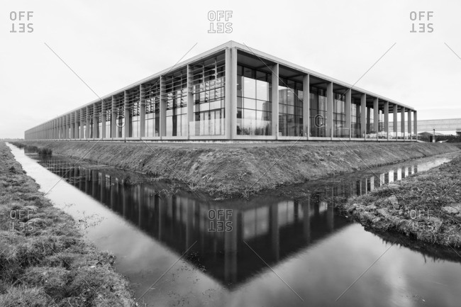 Modern building by reflective canal