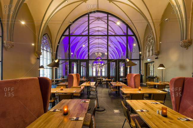 Breda, Netherlands - November 28, 2016: Breakfast room by chapel, Hotel Nassau