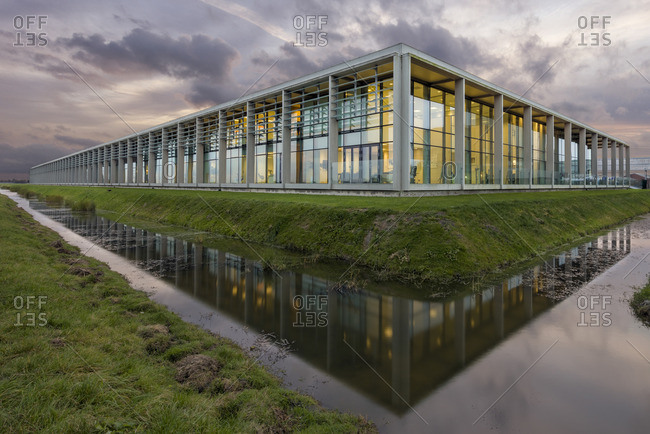 Modern building by a reflective canal