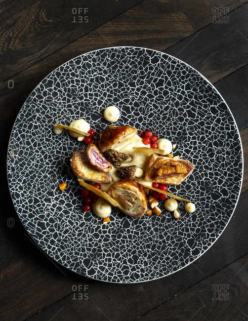 Quail, black salsify, morel and almonds dish at restaurant field, Prague, Czech Republic