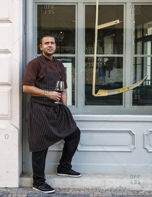 Prague, Czech Republic - May 6, 2016: Chef standing outside of the Restaurant Field, Prague, Czech Republic
