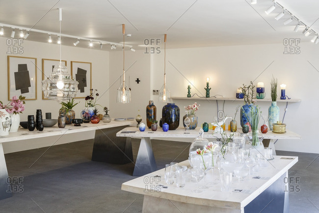 Prague, Czech Republic - May 7, 2016: Unique glass vases and lamps in Cihelna Concept Store, Prague, Czech Republic