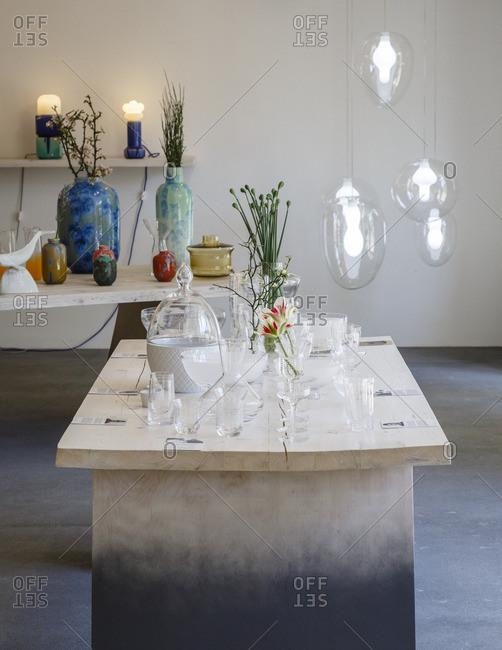 Prague, Czech Republic - May 7, 2016: Unique glass vases on a table in Cihelna Concept Store, Prague, Czech Republic