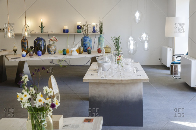 Prague, Czech Republic - May 7, 2016: Unique glass vases filled with plants and flowers in Cihelna Concept Store, Prague, Czech Republic