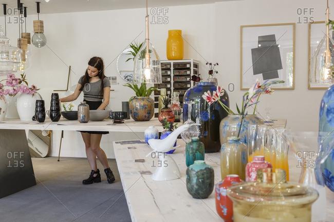 Prague, Czech Republic - May 7, 2016: Woman browsing in Cihelna Concept Store, Prague, Czech Republic