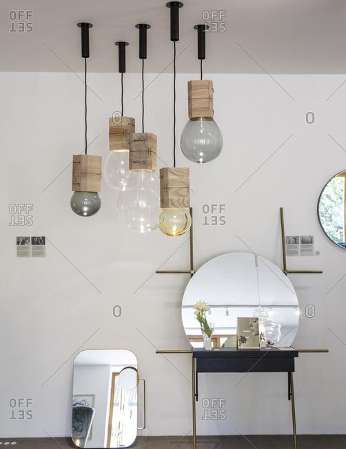 Prague, Czech Republic - May 7, 2016: Unique pendant lights and mirrors in Cihelna Concept Store, Prague, Czech Republic