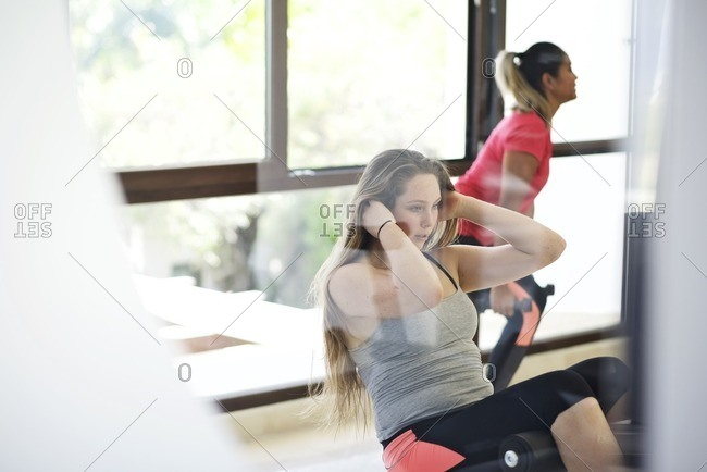 Woman doing sit-ups at a gym