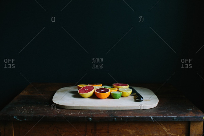 Variety of citrus fruits on a cutting board