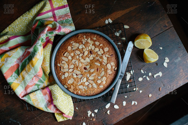 Overhead view of lemon cake with chopped almonds