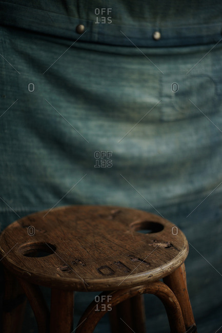 Vintage cafe stool with holes in the seat