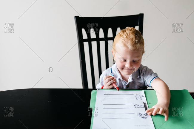 Girl sitting at table with homework