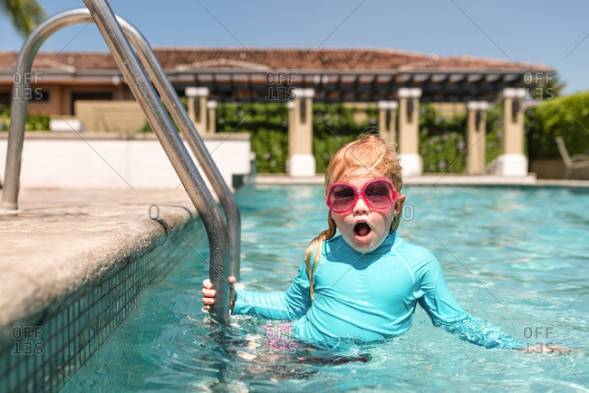 Girl in sunglasses in swimming pool