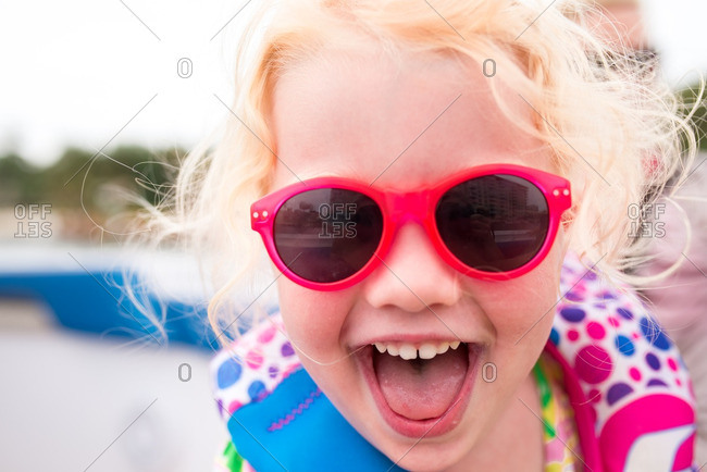 Girl in sunglasses making happy face