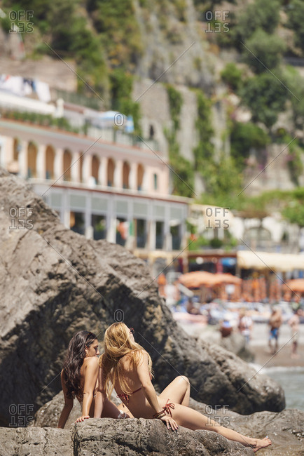 Women sunbathing off Italian coast