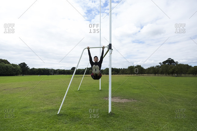 Athlete exercising on goal on sports field