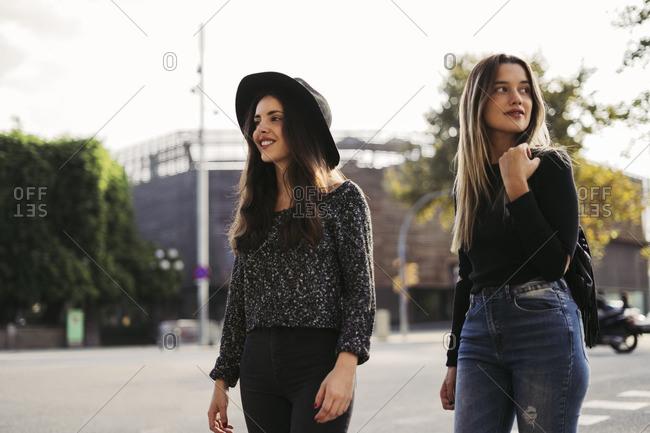 Two best friends walking in the city