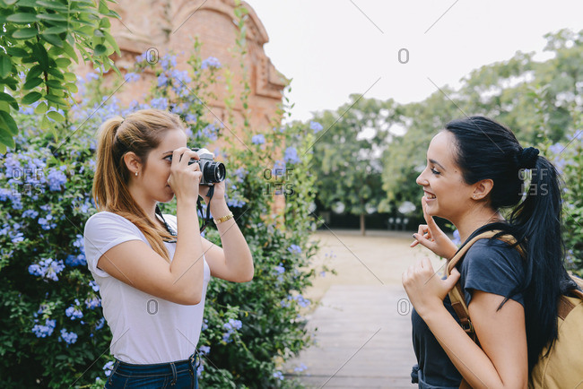 Woman taking picture of her friend