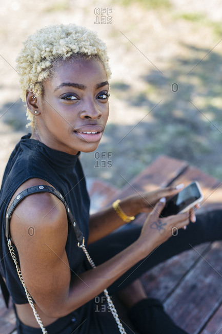 Portrait of young woman holding cell phone