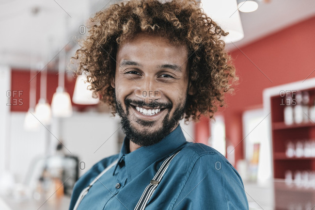 Young man with curly hair- laughing