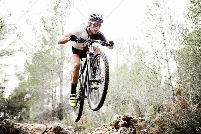 Mountain biker jumping midair - Offset