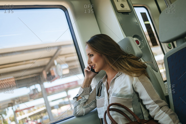 Woman on a train talking on cell phone