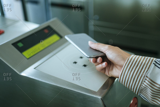Close-up of woman's hand paying with mobile phone