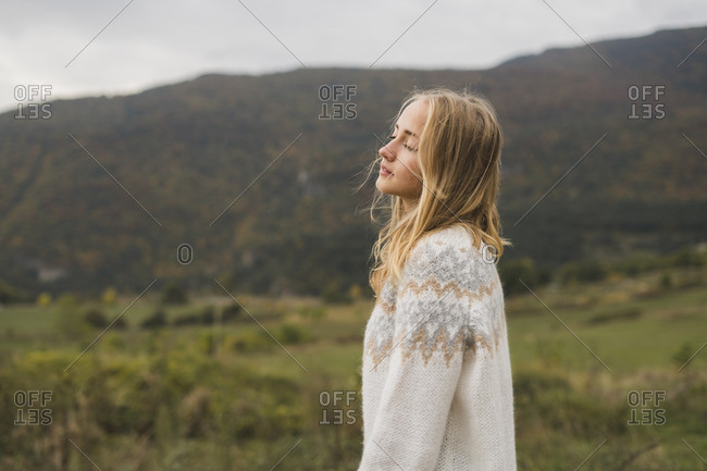 Young woman wearing pullover outdoors